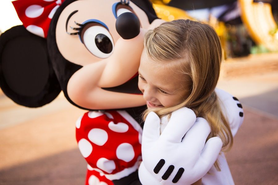 Little girl with Minnie Mouse with your Disney tickets