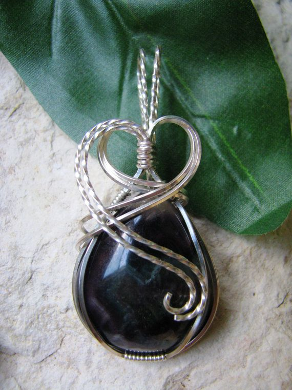 Nice teardrop-shaped fluorite cabochon wrapped in Argentium silver wire.    Pendant is approximately 2 1/2 inches long and 1 1/8 inches wide.