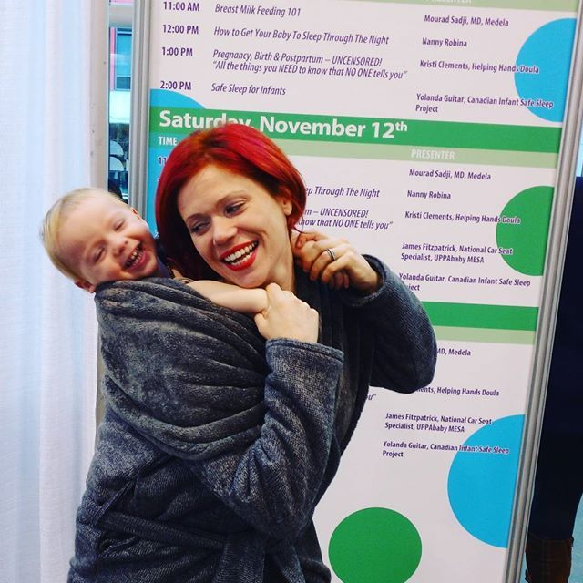 In our #layeryourlove coat at the #babytimeshow <3   #carrythem #babywearing #babywearingforthewin #wearallthebabies