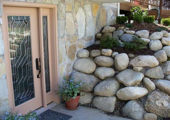 Rock retaining walls are a perfect compliment to any landscape, especially on the east side of Salt Lake City because of their natural abundance. Landscape boulders ranging from 18-48 inches set to retain and create aesthetic planters.