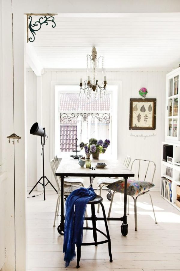 White dinning room with boho details,
