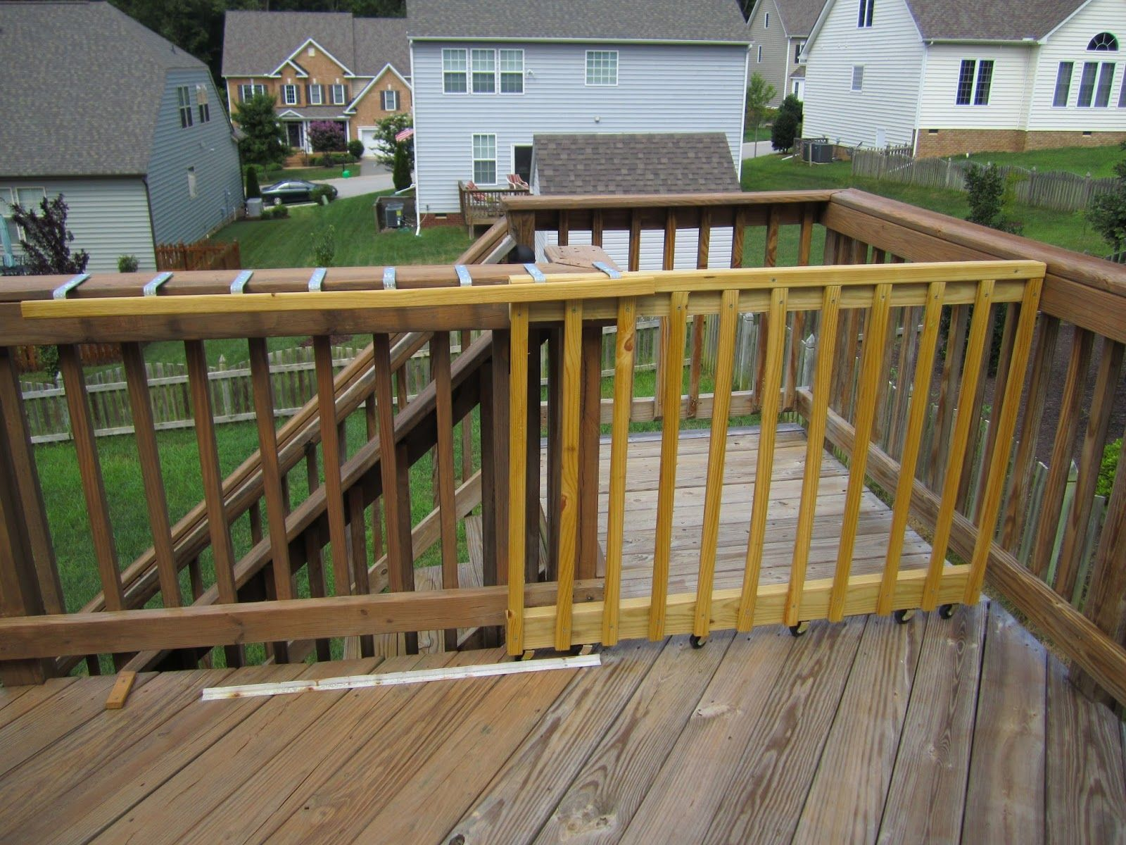 Diy A Sliding Gate For My Deck Deck Gate Sliding Gate Deck