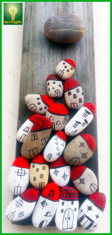 Cuadro palet con piedras decoradas manualidades para - Manualidades con piedras de playa ...