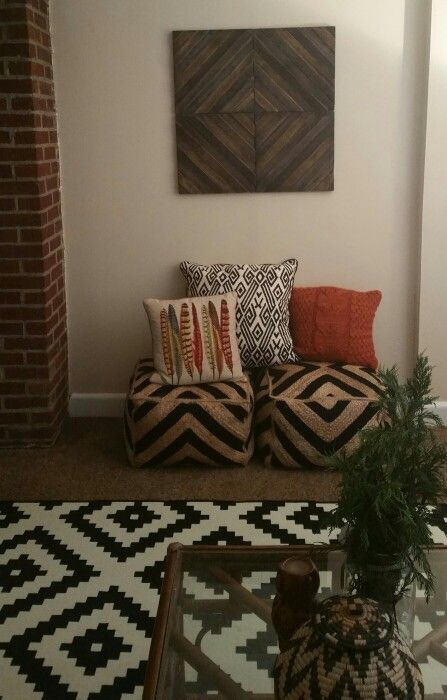 Mixed patterns and text. I LOVE my feather pillows as well. So comfy. I love the bohemian style with a modern touch.