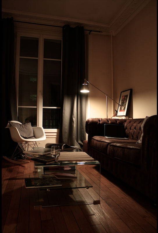 Men's living room, chesterfield couch, glass coffee table, Eames rocking chair.  @ Paris - France  #eames #chesterfield #cofeetable #grey #lounge #paris #france