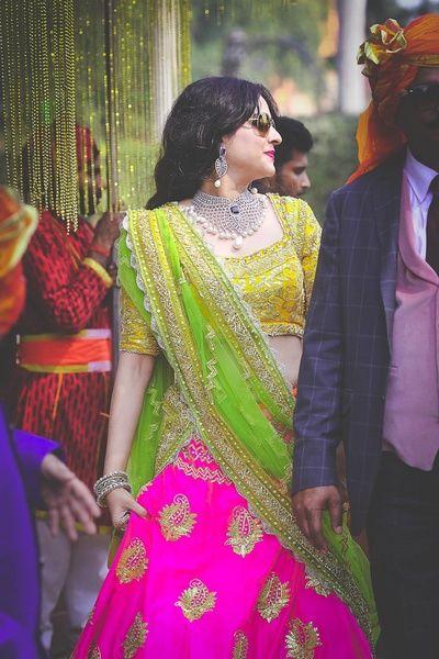 Sangeet Lehengas - Pink Fuchsia Lehenga with Lime Green Dupatta and Yellow Blouse | WedMeGood  #wedmegood #indianbride #indianwedding #pink #lehenga #limegreen #yellow #jewelry