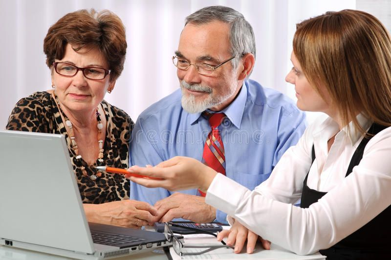 Meeting. Senior couple meeting with insurance agent or