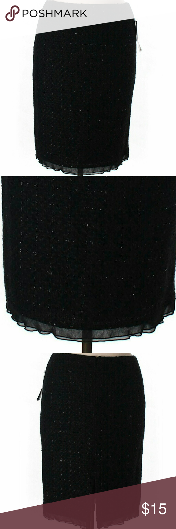 "Pencil Wool Skirt Pencil black with sparkly thread skirt. It's a wool, acrylic, nylon blend with a frill hem. Hidden back zipper and slit for freedom of movement. 23"" lenght. Looks like new! Nine West Skirts Pencil"
