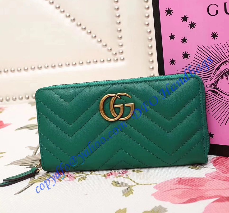 8c66268e20e2 Gucci GG Marmont zip around wallet in Green leather with a chevron design