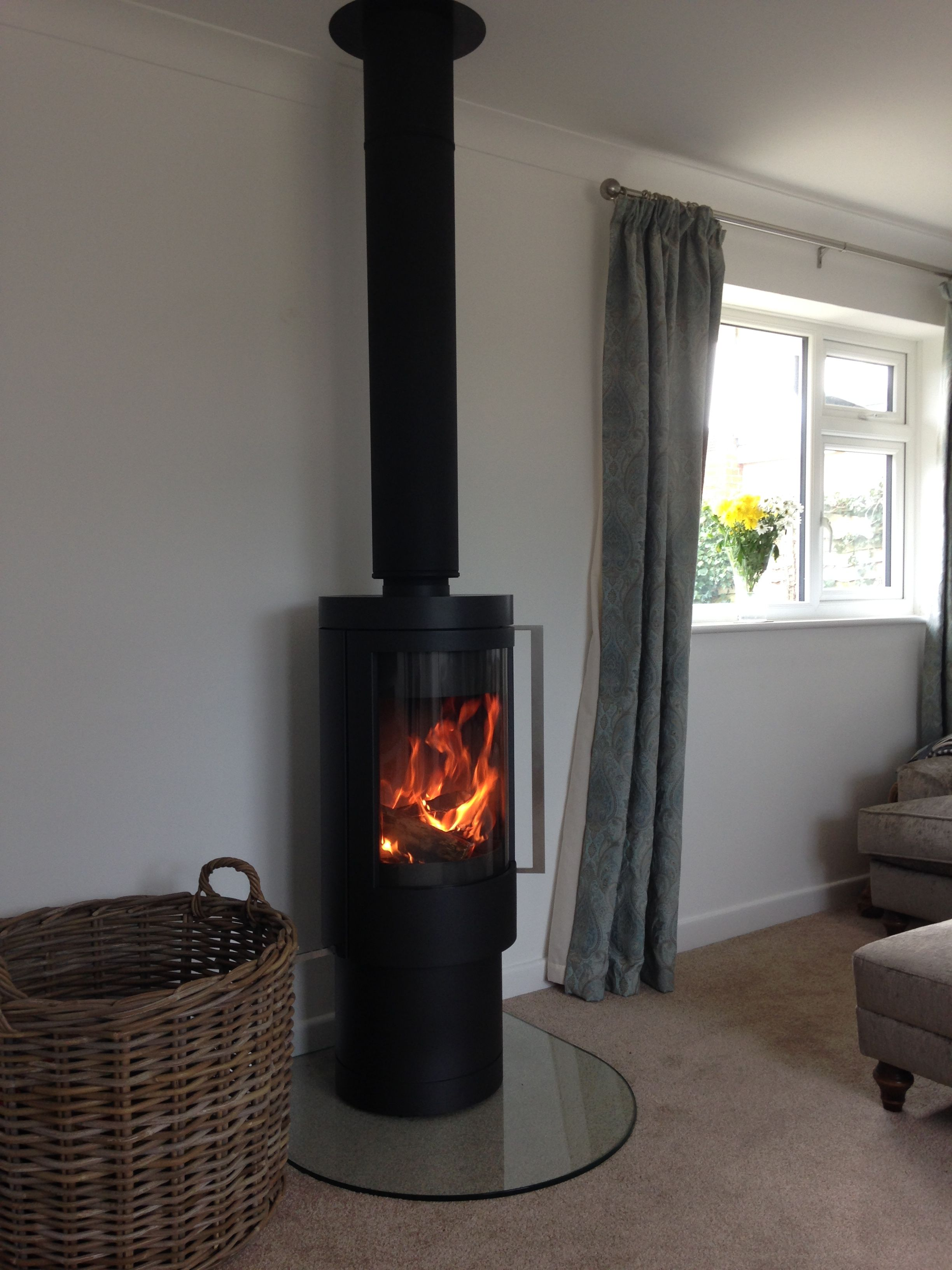 a rais viva in grey on a stainless steel twin wall flue