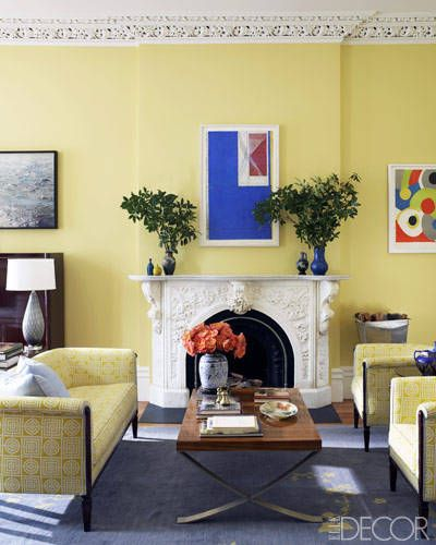Artwork in the living room includes, from  left, a photo by Mark Heithoff and prints by Richard Diebenkorn and Sonia  Delaunay; the zebrawood cocktail table has a stainless-steel base. Sheila Bridges