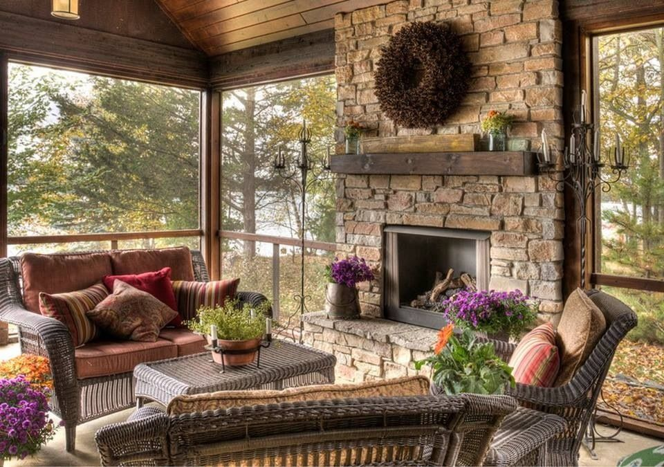 Rustic Screened Porch With Stone Fireplace And Warm Wood Ceiling