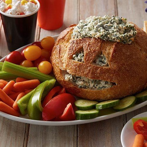 Jack-o'-Lantern Spinach Dip Bread Bowl #halloweenpotluckideas
