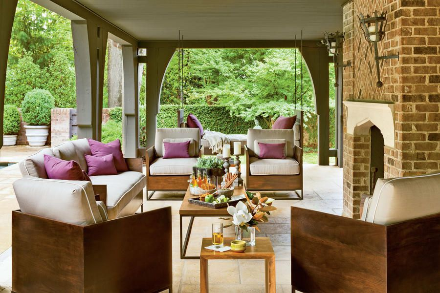 Refined Rustic Back Porch - 80 Breezy Porches and Patios - Southernliving. Decorator Cindy Smith of Circa Interiors, Charlotte, NC, used purple accents in addition to wood, metal, and stone to create a refined, rustic back porch design.  See more of this Refined Rustic Back Porch