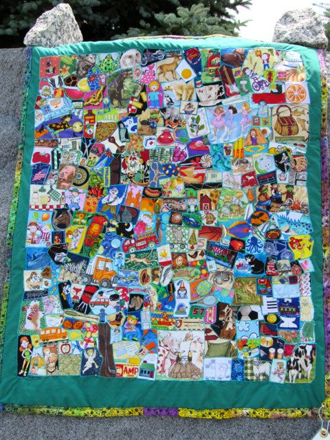 I spy quilt done in a crazy quilt style of many shapes & sizes