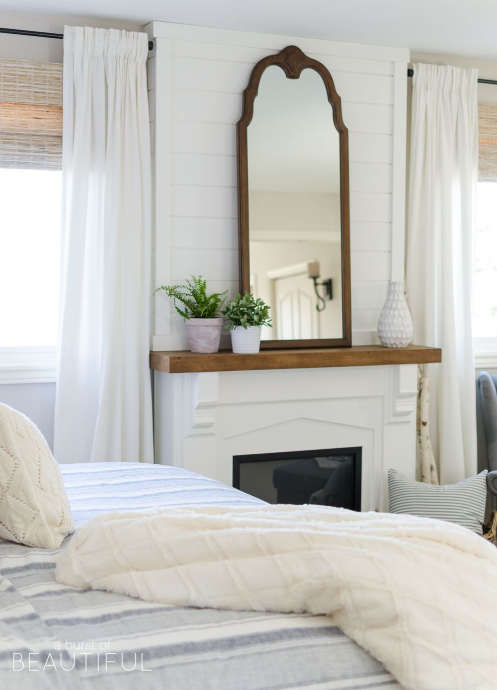 cozy farmhouse master bedroom shiplap fireplace farmhouse
