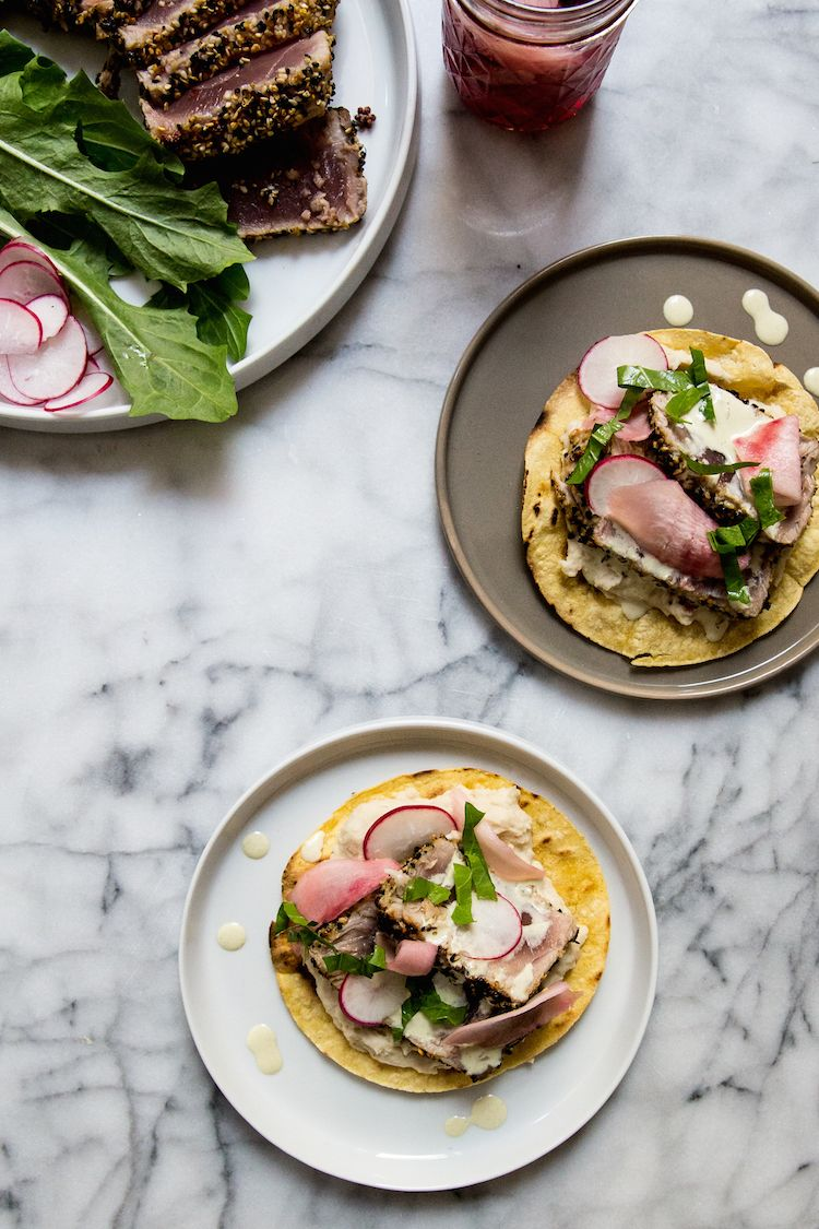 Seared tuna tostadas with white bean and Japanese 7-spice at feedmedearly.com | Corn tortilla, tuna steak, black radish, purple turnip, beet, white beans, shiso dressing, wasabi powder, mayonnaise, dandelion greens | Recipe, Asian