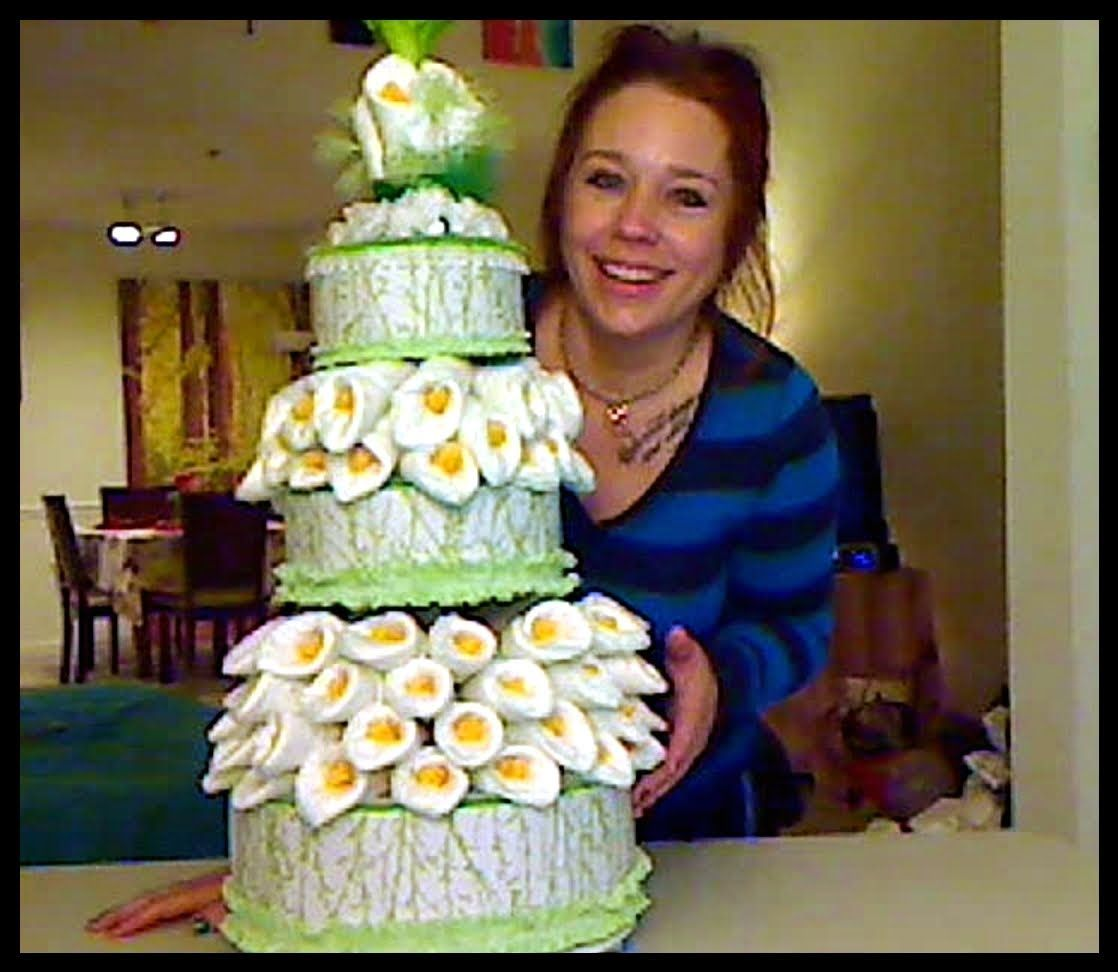 How to make a diaper lily cake baby diaper washcloth gifts one of the most beautiful diaper cakes ever created this lily diaper cake is an original work of art easy instructions are given to create this cake at publicscrutiny Image collections