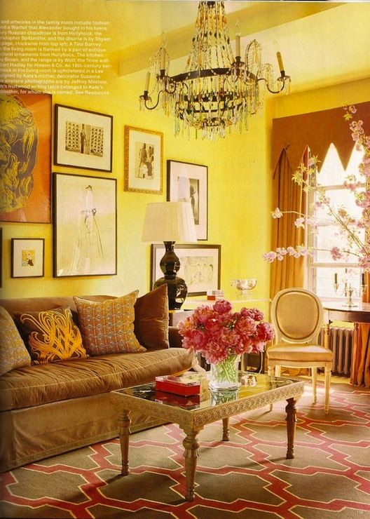 Living Room Pink And Brown Moroccan Tile Rug, Brown Slipcpvered Sofa, Black  Gourd Lamp, Crystal Chandelier And Yellow Walls Paint Color.