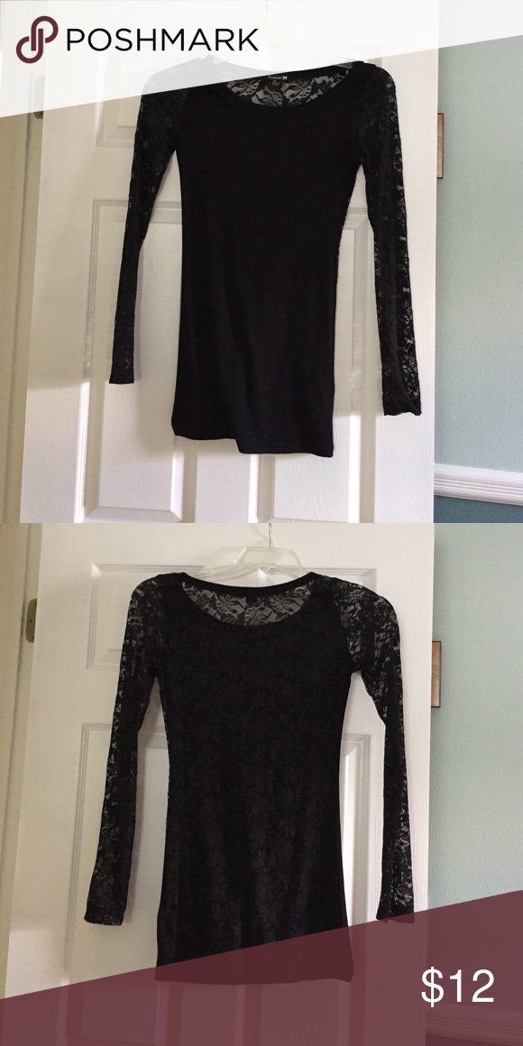 Long sleeved lace shirt complete lace back Fun black long sleeved shirt for going out. Lace arms and back. Front is plain black cotton material. Fits tight. Size large but fits more like a small or medium. Forever 21 Tops Tees - Long Sleeve