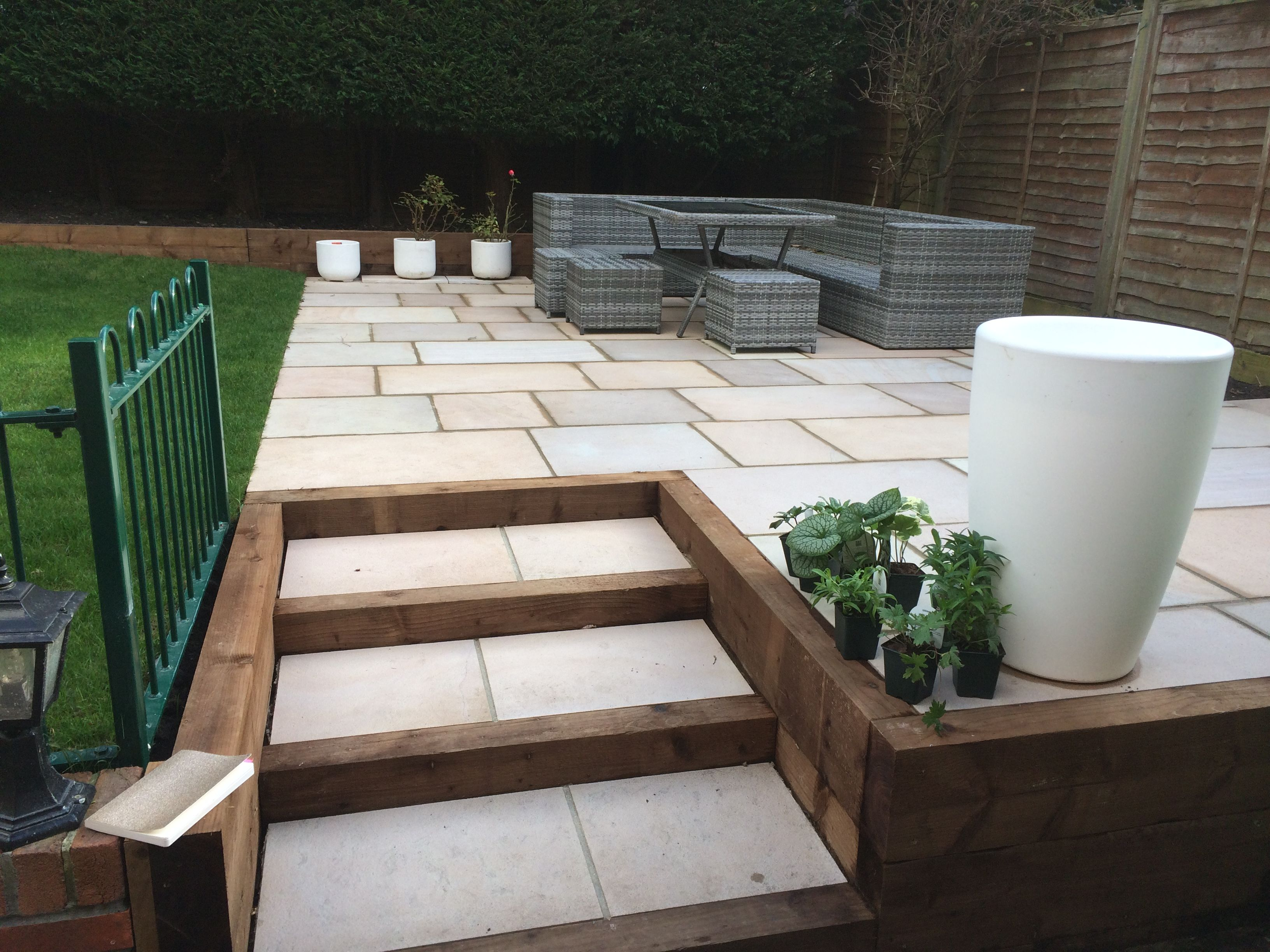Raised Patio Area With Incorporated Steps Within Timber