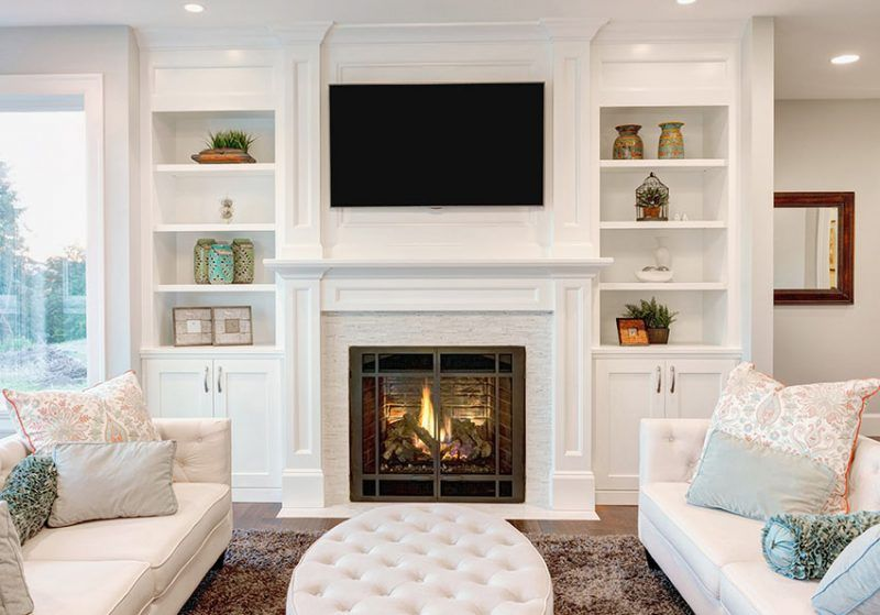 decoration ideas for small living room with fireplace rooms black leather sofas decorating tips to make a feel bigger built in book shelves
