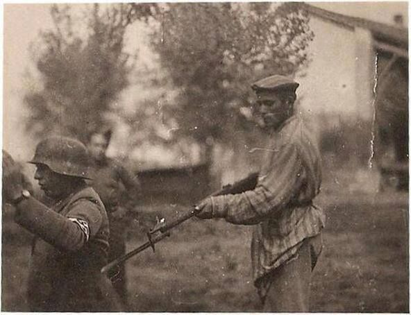 A liberated Jewish man holds a German soldier at gunpoint at the end of the second World War. http://wrhstol.com/2fzQxk6