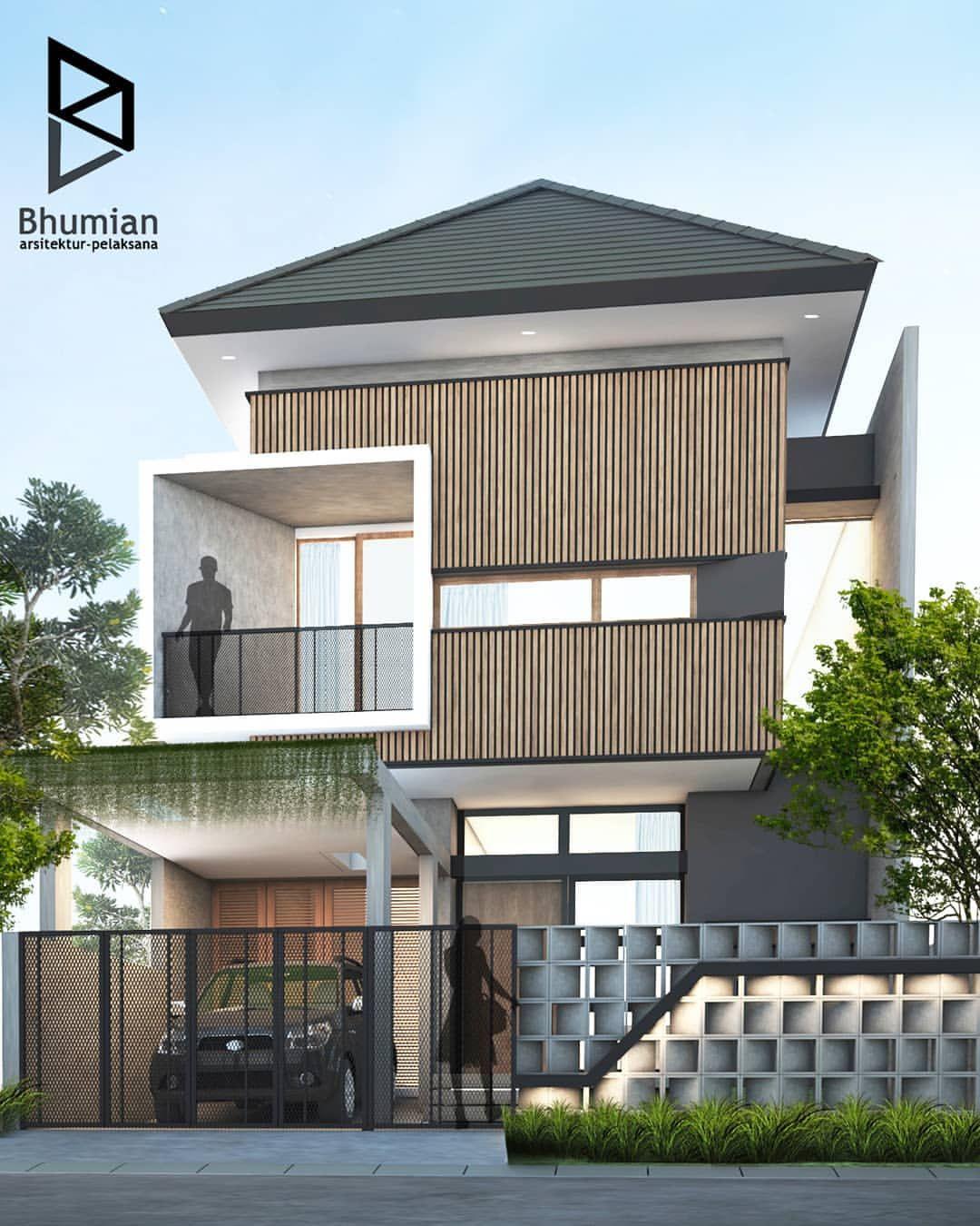 Desain Rumah Berkonsep Minimalis Kontemporer Dengan Permainan Kayu Sebagai Aksen Fasad Membuat Rumah Ini Terli Desain Rumah Kontemporer Rumah Kontemporer Rumah