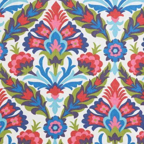 Felicity Firecracker Jaxson Round Upholstered Ottoman | World Market