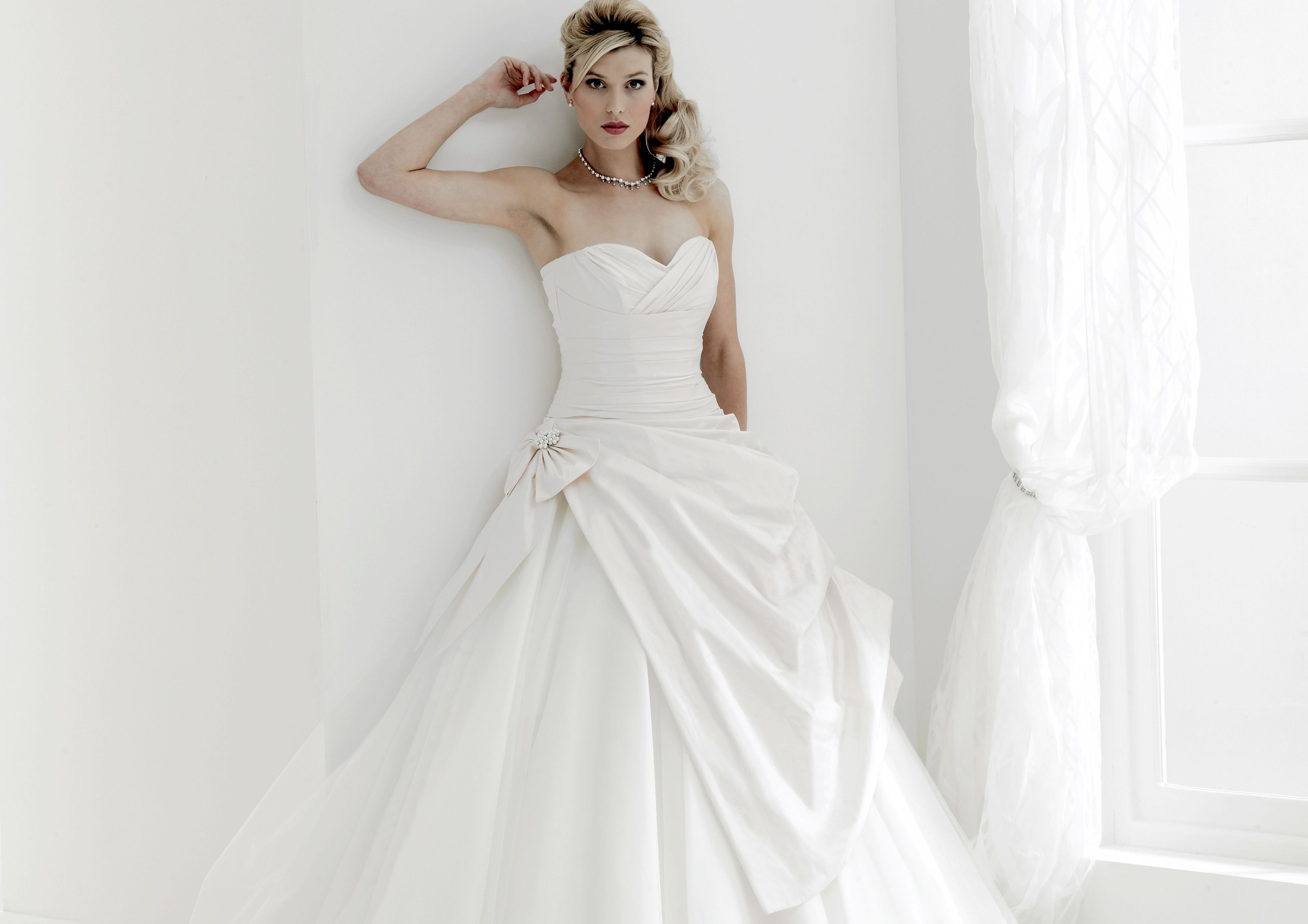 Best seller from Nicola's Splendour Collection - Bijou has couture styling with silk bodice and apron over contrasting tulle hooped skirt