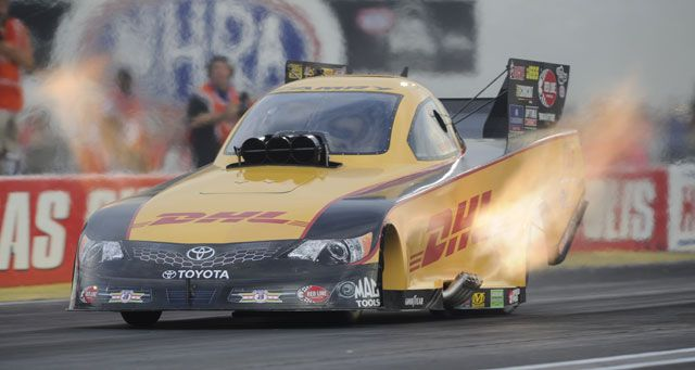 The Dhl Toyota Camry Funny Car With The Flames Up At The 2012 Mac