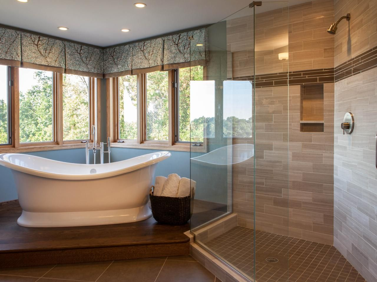 A freestanding soaking tub mixes beautifully with the oversized ...