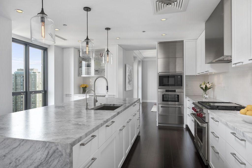 An All White Modern Contemporary Kitchen In Chicago S Waldorf Astoria Dres Modern Kitchen Design Modern Kitchen Island Design White Kitchen Remodeling