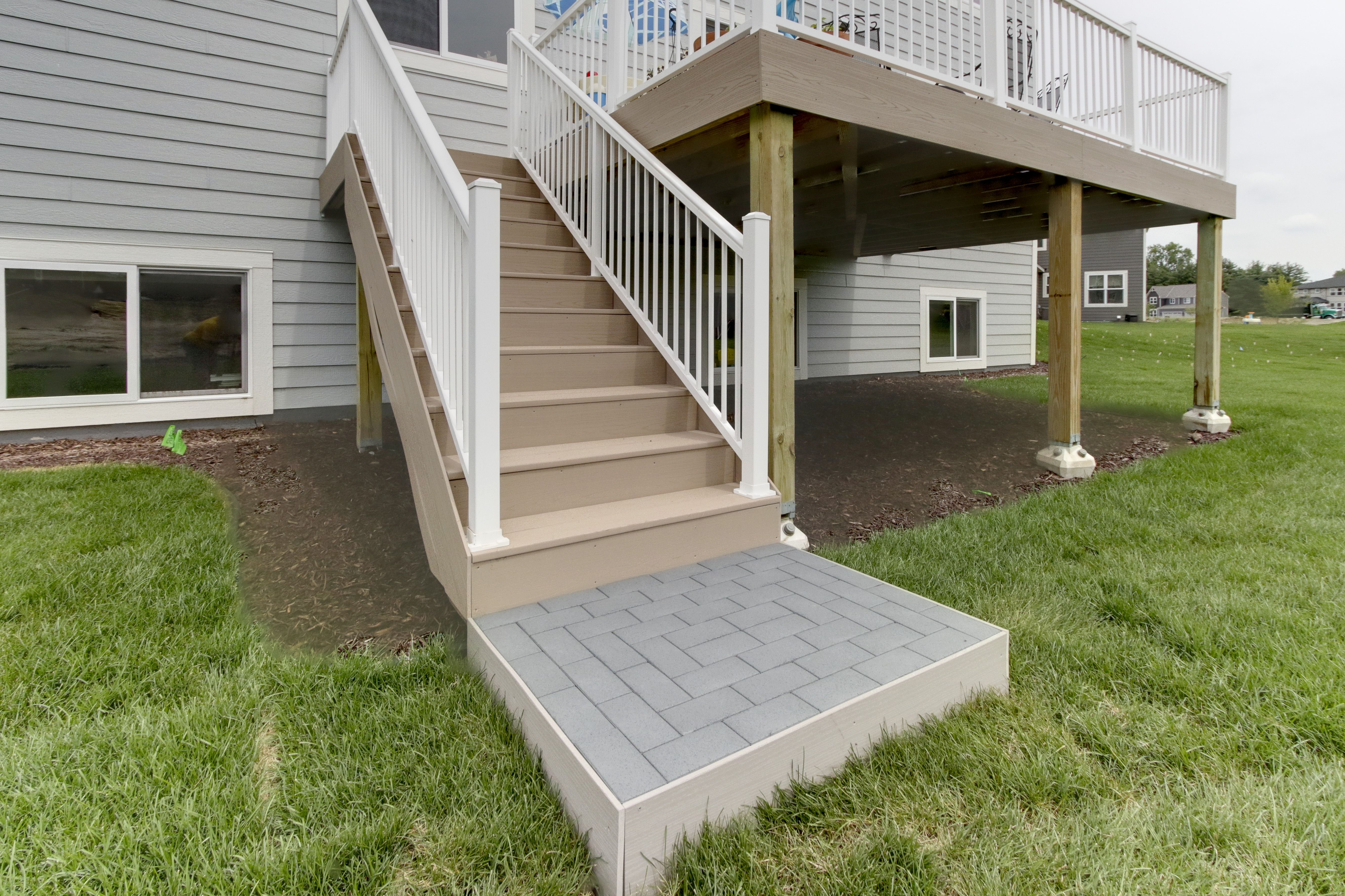 landing pad for staircase with azek recycled pavers deck
