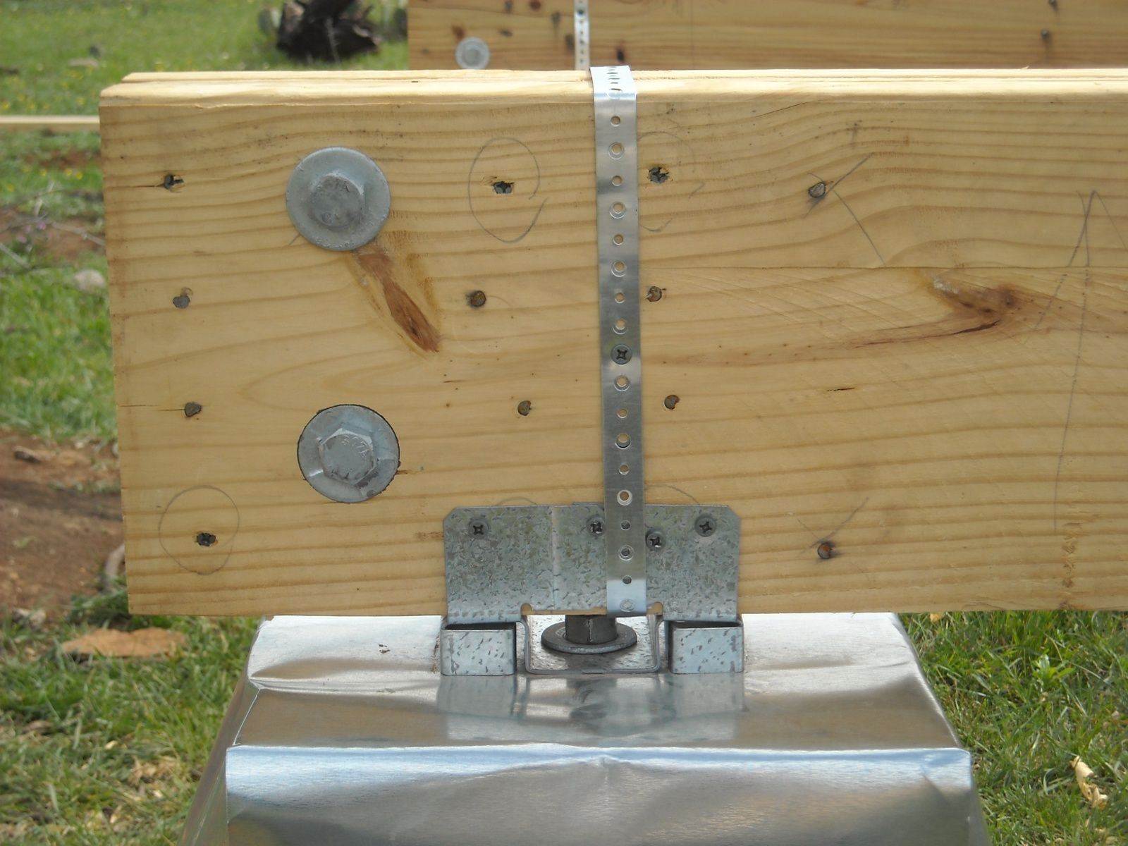 Tying the beams to the concrete pier brackets using metal for Foundation piers