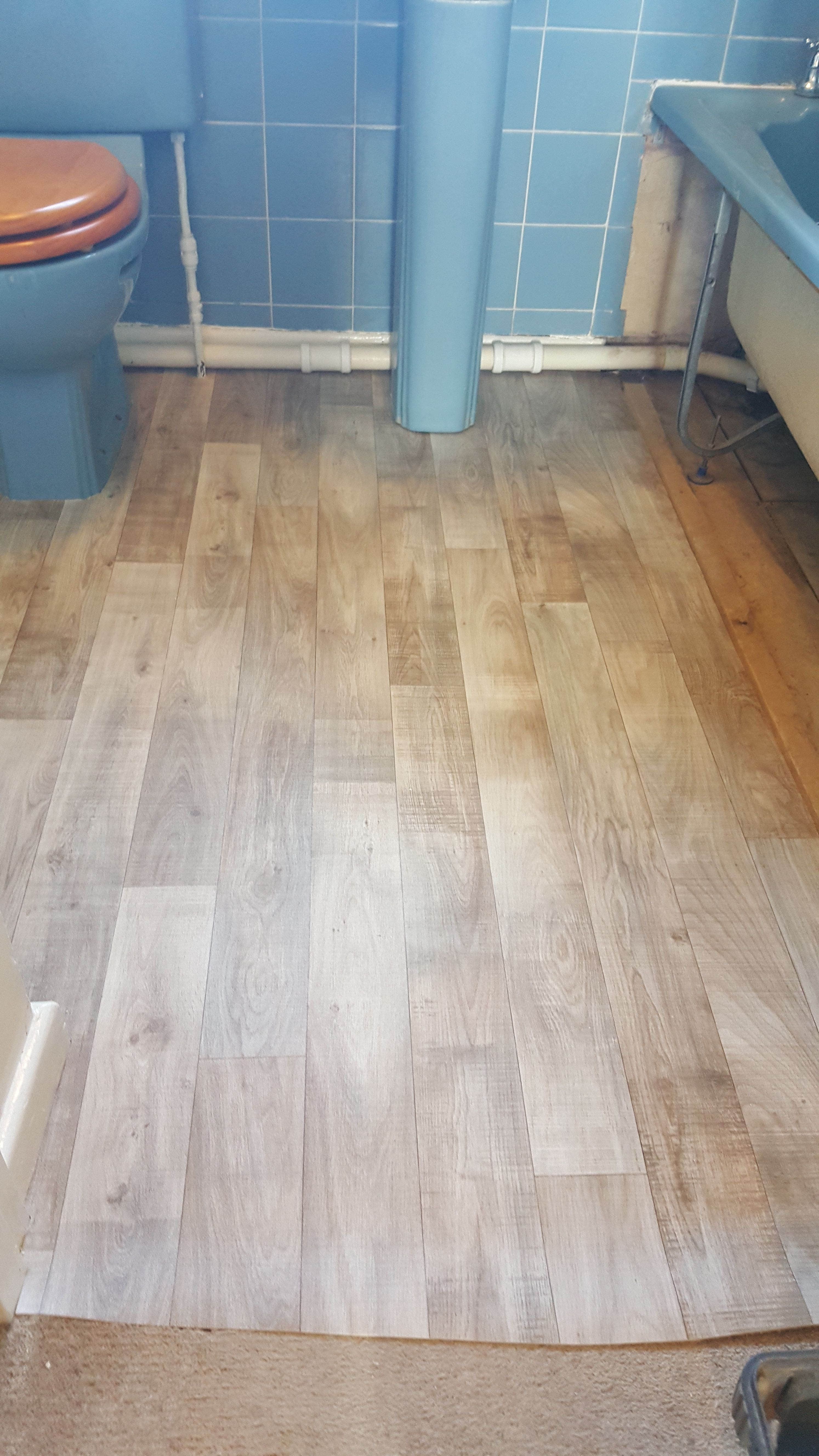 Wood Effect Vinyl Flooring Fitted To A Bathroom At Costessey Laid On 6 Mm Fg1 Rated Plywood Due To Very Uneven Fl Vinyl Flooring Flooring Vinyl Tile Flooring