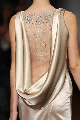 Netting, lace and adornments are a nice way to give a deep plunge some modesty.