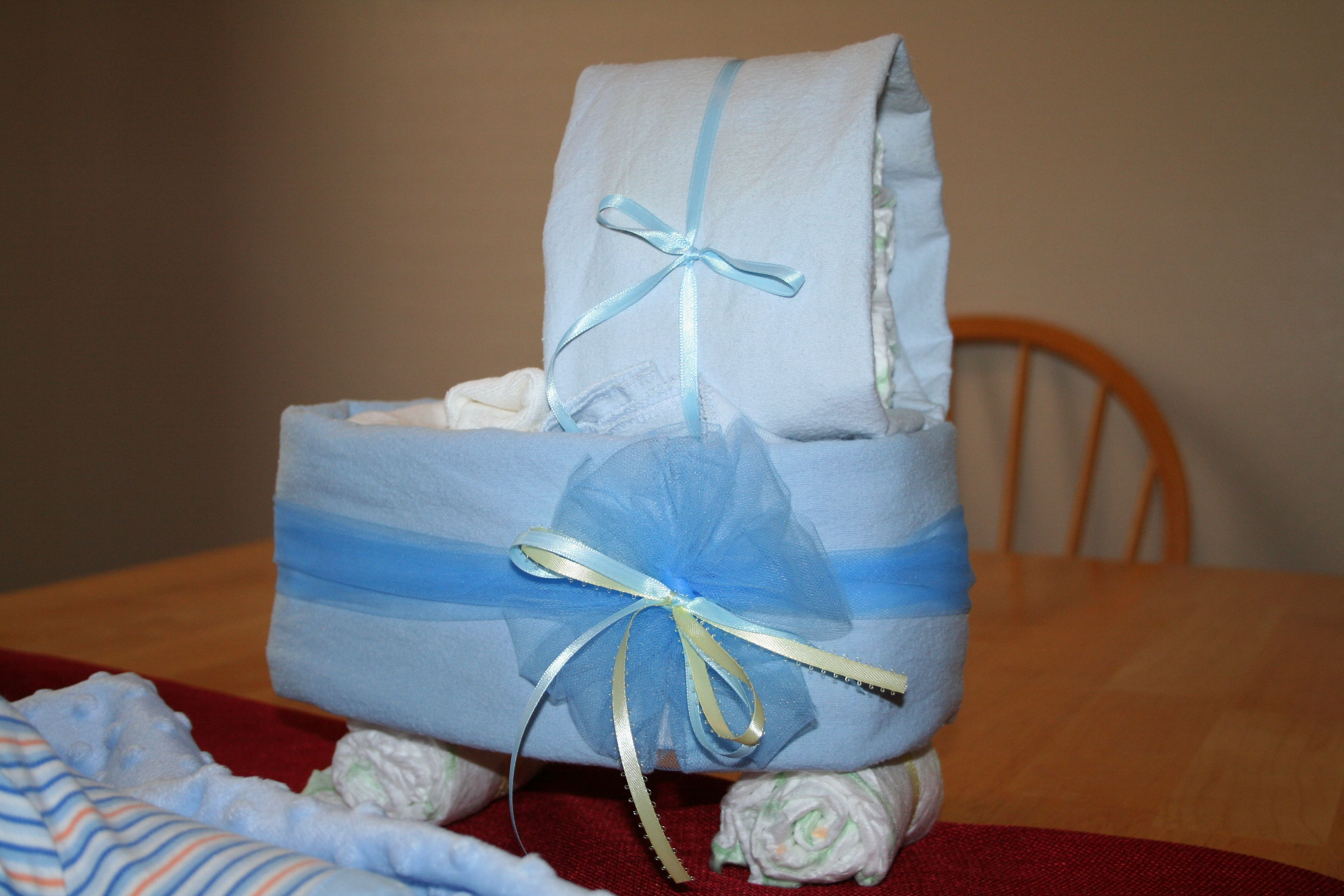 Made with diapers, blankets, and rubberbands and ribbon great for babyshowers decoration
