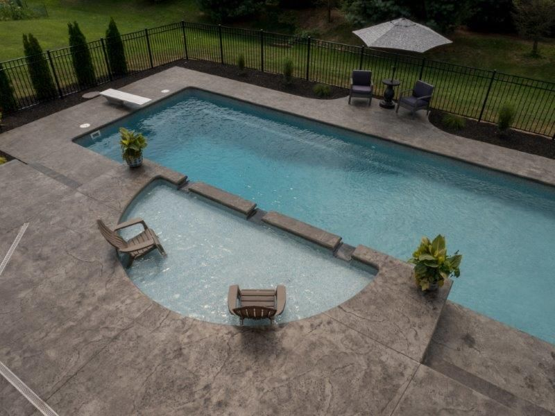 Island Breeze Style Fiberglass Pool With Tanning Ledge Stamped Concrete Patio Tanning Ledge Pool Tanning Ledges Stamped Concrete Patio
