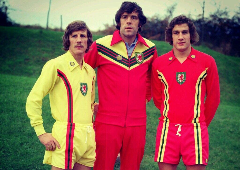 Gil Rees, Mike England and Phil Dwyer show off the new Wales kits and tracksuit from Admiral in 1976.