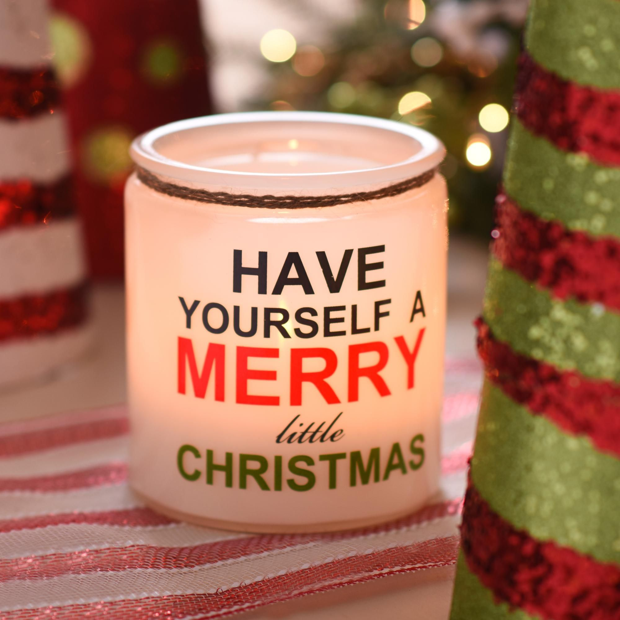 Simple but sweet. Place your favorite holiday candle inside the candle holder that reads Have Yourself a Merry Little Christmas. It will bring a smile to everyone's faces!