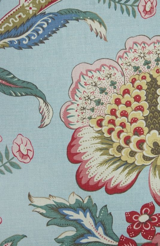 Ashby Linen Fabric Traditional floral fabric inspired by Indian Palampores, in reds with greens, and a aqua background.