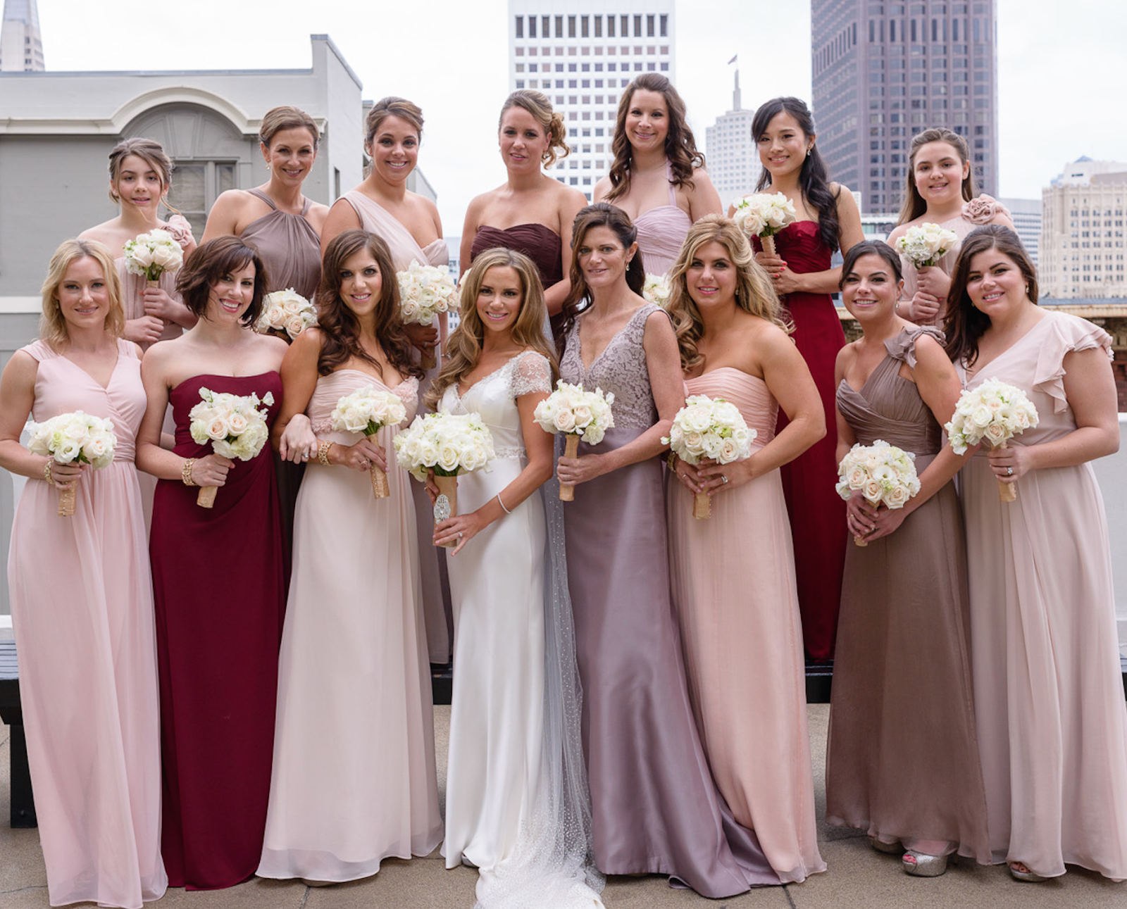 7ab721ecec Bridesmaids in various dress colours pinks,burgundy,blush,taupe ...