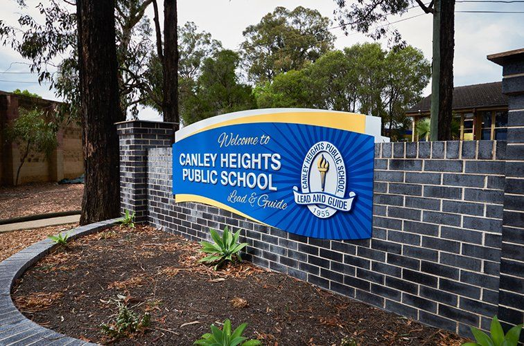 At Canley Heights Danthonia Designs Danthoniadesign Twitter School Signage School Building Design Wall Signage