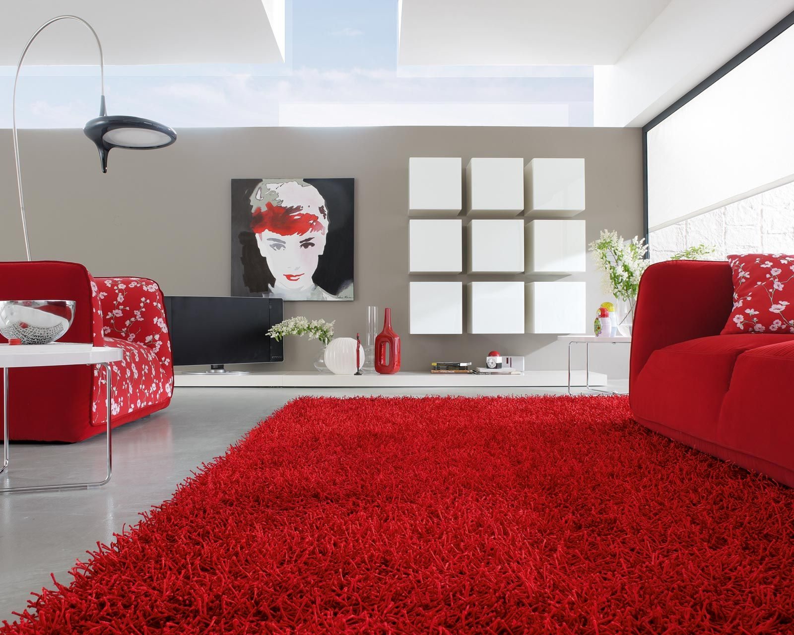 This modern room setting uses rhythm with the colour red rather