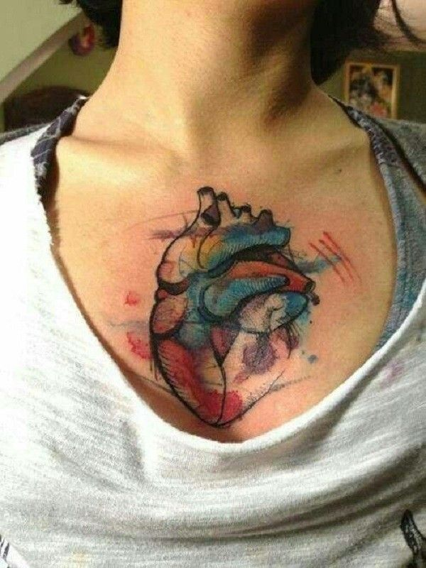 Heart Watercolor Tattoos On Chest For Woman Watercolor Heart Tattoos Heart Tattoo Trendy Tattoos