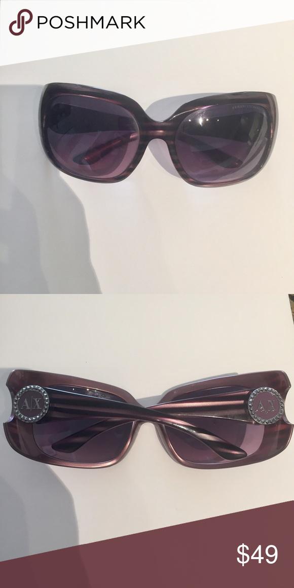 0ffc1dfb0f12 Armani Exchange Sunglasses Fun sunglasses with purple subtle stripes. A X  logo on corners with rhinestones Armani Exchange Accessories Sunglasses