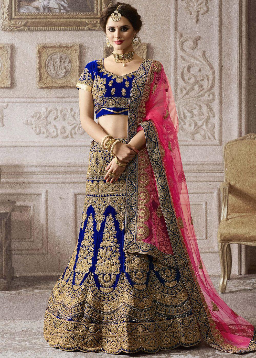 d4f0e63fb8 Blue Velvet Bridal Lehenga Choli with all over heavy zari embroidery and  kundan work.
