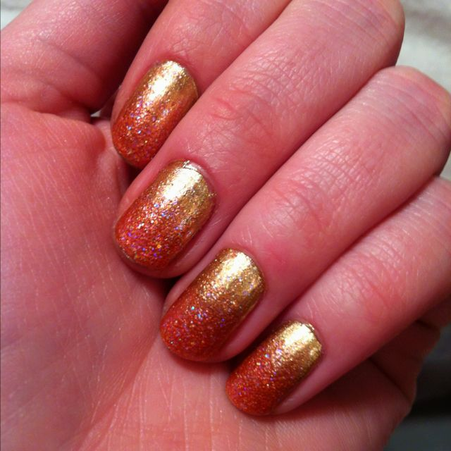Nails right now! Ombré sparkles... Need to remember this trick.