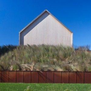 Shingle-clad house by Bates Masi Architects mimics Long Islandpotato barns